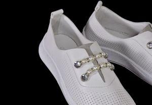 kožená a atestovaná obuv Dámské kožené tenisky s perforací 4085, bílé Marcella